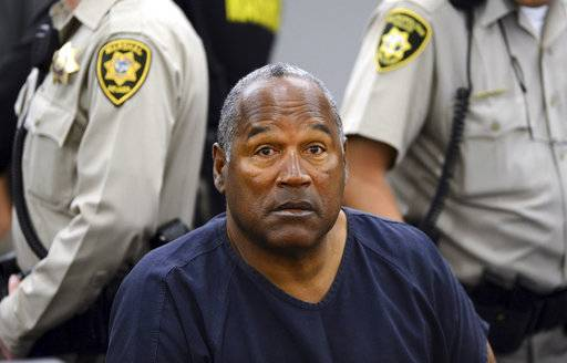 FILE - In this May 14, 2013, pool file photo, O.J. Simpson sits during a break on the second day of an evidentiary hearing in Clark County District Court in Las Vegas. Simpson, the former football star, TV pitchman and now Nevada prison inmate, will have a lot going for him when he appears before state parole board members Thursday, July 20, 2017 seeking his release after more than eight years for an ill-fated bid to retrieve sports memorabilia. A Nevada prison official said early Sunday, Oct. 1, 2017, O.J. Simpson, the former football legend and Hollywood star, has been released from a Nevada prison in Lovelock after serving nine years for armed robbery.