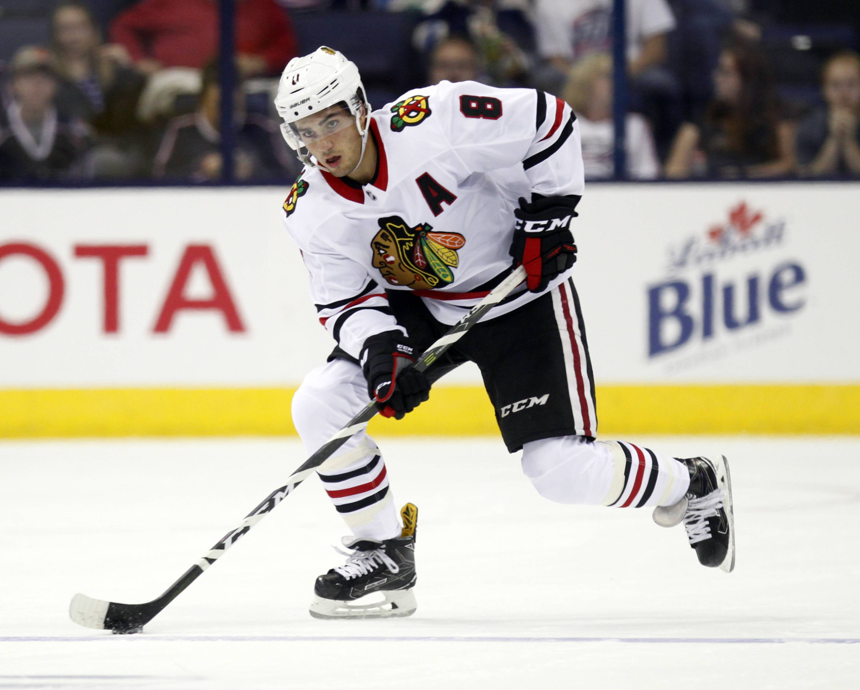 Chicago Blackhawks forward Nick Schmaltz carries the puck against the Columbus Blue Jackets during a preseason NHL hockey game in Columbus, Ohio, Tuesday, Sept. 19, 2017.