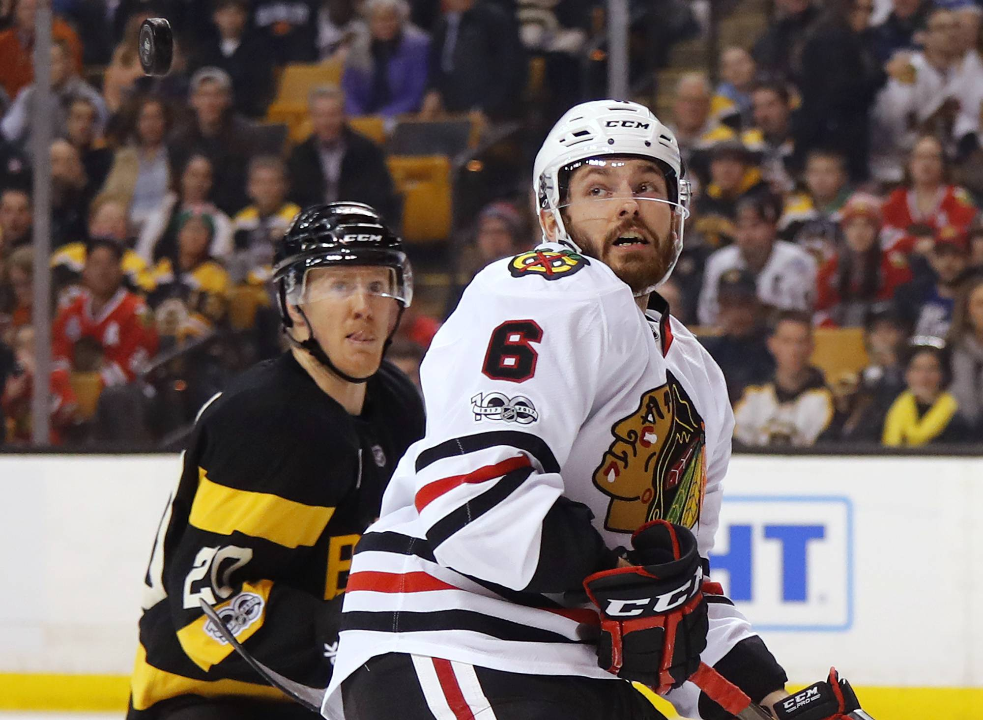 Chicago Blackhawks defenseman Michal Kempny (6) and Boston Bruins' Riley Nash watch the puck during the second period of an NHL hockey game in Boston on Friday, Jan. 20, 2017.