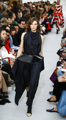 A model wears a creation for Celine Spring-Summer 2018 ready-to-wear fashion collection presented Sunday, Oct.1, 2017 in Paris.