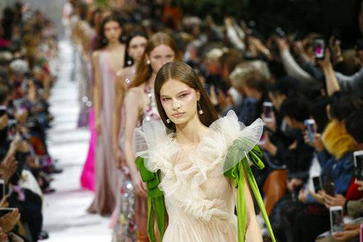 Models wear creations for Valentino Spring/Summer 2018 ready-to-wear fashion collection presented in Paris, Sunday, Oct. 1, 2017.