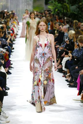 A model wears a creation for Valentino Spring/Summer 2018 ready-to-wear fashion collection presented in Paris, Sunday, Oct. 1, 2017.