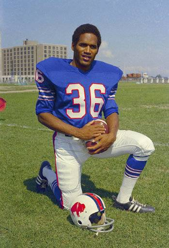 FILE - In this 1969 file photo, shows O.J. Simpson, football player for the Buffalo Bills. 1969: The first pick in the pro draft, Simpson goes to the Buffalo Bills and spends the next nine seasons with the team. O.J. Simpson's release from a Nevada prison turns another page in one of the most dramatic falls from grace in American pop culture history. A beloved college and pro football hero in the 1960s and '70s, Simpson went on to become a movie star, sports commentator and TV pitchman in the years before the 1994 killings of his ex-wife and her friend in Los Angeles. A Nevada prison official said early Sunday, Oct. 1, 2017, O.J. Simpson, the former football legend and Hollywood star, has been released from a Nevada prison in Lovelock after serving nine years for armed robbery.