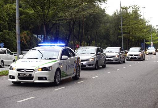 Police cars carrying Vietnamese suspect Doan Thi Huong and Indonesian suspect Siti Aisyah enter the Shah Alam court house at Shah Alam outside Kuala Lumpur, Malaysia on Monday, Oct. 2, 2017. The trial of two women accused of poisoning the estranged half brother of North Korea's ruler is scheduled to begin Monday in Malaysia's High Court, nearly eight months after the brazen airport assassination.
