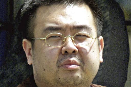 FILE - This May 4, 2001, file photo shows Kim Jong Nam, exiled half brother of North Korea's leader Kim Jong Un, in Narita, Japan. The trial of two women accused of poisoning the estranged half brother of North Korea's ruler is scheduled to begin Monday, Oct. 2, 2017, in Malaysia's High Court, nearly eight months after the brazen airport assassination. Siti Aisyah of Indonesia and Doan Thi Huong of Vietnam are suspected of smearing Kim Jong Nam's face with the banned VX nerve agent on Feb. 13 at a crowded airport terminal in Kuala Lumpur, killing him within about 20 minutes. The women say they thought they were playing a harmless prank for a hidden-camera show.