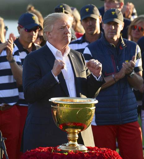 President Donald Trump participates in presenting the Presidents Cup to the United States team at the Jersey City Golf Club in Jersey City, N.J., Sunday, Oct. 1, 2017, after the United States team defeated the International team in the Presidents Cup for the 7th straight time.