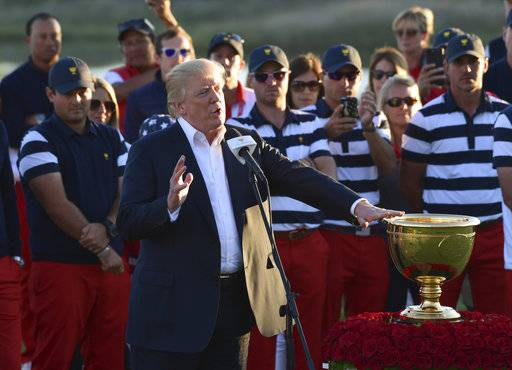 President Donald Trump dedicates the Presidents Cup to those affected by the hurricanes during a ceremony to present the cup to the United States team at the Jersey City Golf Club in Jersey City, N.J., Sunday, Oct. 1, 2017.