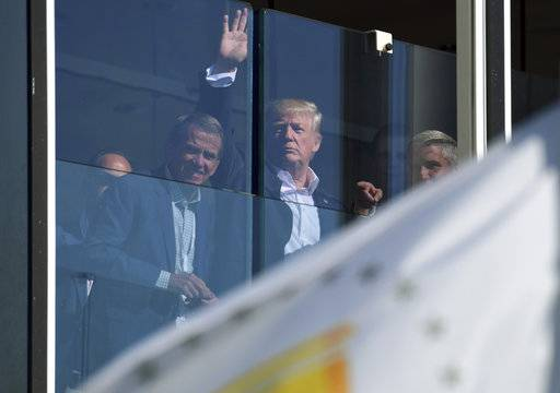 President Donald Trump watches the Presidents Cup golf tournament in Jersey City, N.J., Sunday, Oct. 1, 2017. The President of the United States is the Honorary Presidents Cup Chairman.