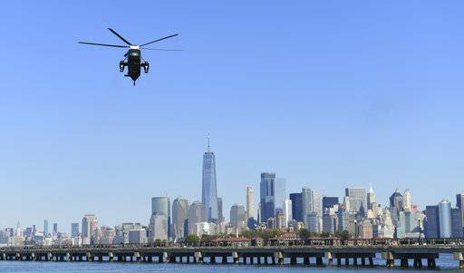 Marine One, with President Donald Trump on board, flies past the Manhattan skyline as it heads to the Liberty Park landing zone in Jersey City, N.J., Sunday, Oct. 1, 2017. Trump is heading to attend the Presidents Cup golf tournament.