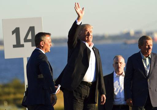 President Donald Trump arrives to participate in presenting the Presidents Cup to the United States team at the Jersey City Golf Club in Jersey City, N.J., Sunday, Oct. 1, 2017.