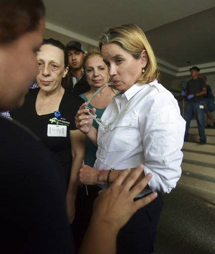 Mayor Carmen Yulin Cruz arrives at San Francisco hospital in Rio Piedras area of San Juan, Puerto Rico, Saturday, Sept. 30, 2017, as about 35 patients are evacuated after the failure of an electrical plant.