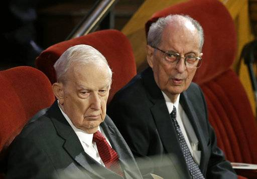 FILE - This July 10, 2015, file photo, shows Senior Mormon leader Robert D. Hales, right, and Richard G. Scott, left, attending the memorial service for Mormon leader Boyd K. Packer at the Tabernacle on Temple Square in Salt Lake City. Senior Mormon leader Robert D. Hales has died at the age of 85. Church spokesman Eric Hawkins said in a statement that Hales died Sunday, Oct. 1, 2017, in a Salt Lake City hospital surrounded by his wife and family.