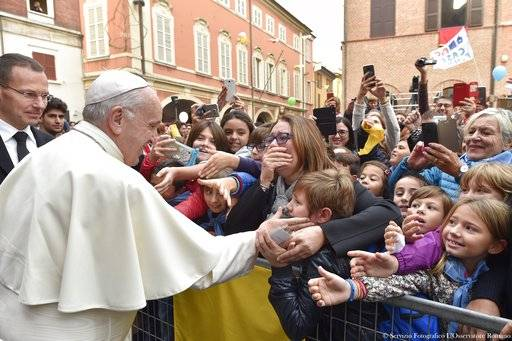 Pope Francis cheers at children during his visit to Cesena, Italy, Sunday, Oct. 1, 2017. Pope Francis is in Cesena and Bologna for a one-day visit. (L'Osservatore Romano/ Pool photo via AP)