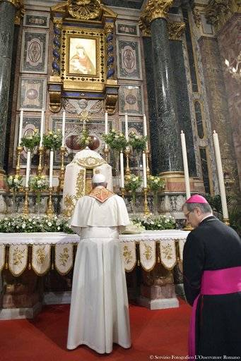Pope Francis, left, prays inside the Cathedral of Cesena, Italy, Sunday, Oct. 1, 2017. Pope Francis is in Cesena and Bologna for a one-day visit. At right the Bishop of Cesena-Sarsina Douglas Regattieri. (L'Osservatore Romano/ Pool photo via AP)