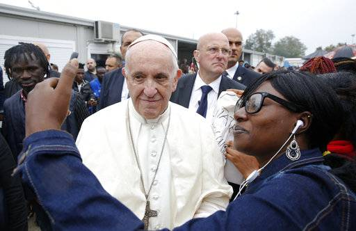 Pope Francis poses for a selfie with a woman during his vist to a regional migrant center, in Bologna, Italy, Sunday, Oct. 1, 2017. Pope Francis is in Cesena and Bologna for a one-day visit.  (Alessandro Bianchi/Pool Photo via AP)