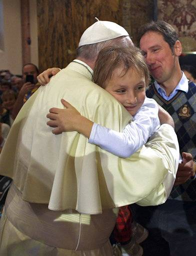 Pope Francis hugs a boy inside the Cathedral of Cesena, Italy, Sunday, Oct. 1, 2017. Pope Francis is in Cesena and Bologna for a one-day visit. (L'Osservatore Romano/ Pool photo via AP)