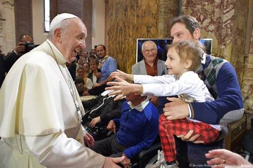 Pope Francis cheers to a boy inside the Cathedral of Cesena, Italy, Sunday, Oct. 1, 2017. Pope Francis is in Cesena and Bologna for a one-day visit. (L'Osservatore Romano/ Pool photo via AP)