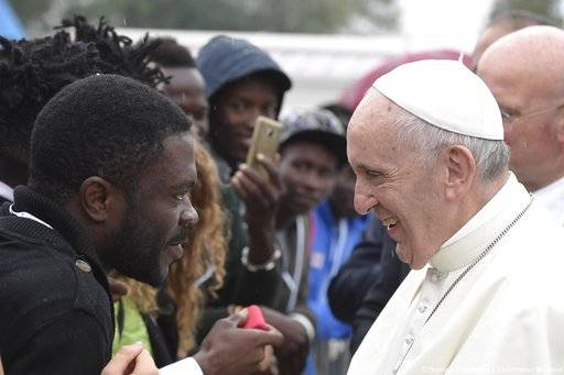 Pope Francis meets with migrants at a regional migrant center, in Bologna, Italy, Sunday, Oct. 1, 2017. Pope Francis is in Cesena and Bologna for a one-day visit. (L'Osservatore Romano/ Pool photo via AP)