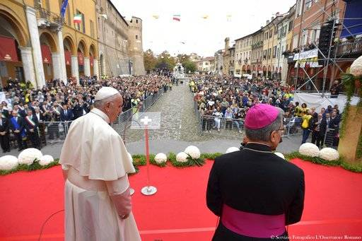 Pope Francis, left, is flanked by Bishop of Cesena-Sarsina Douglas Regattieri as he arrives to speak to the people of Cesena, Italy, Sunday, Oct. 1, 2017. Pope Francis is in Cesena and Bologna for a one-day visit. (L'Osservatore Romano/ Pool photo via AP)