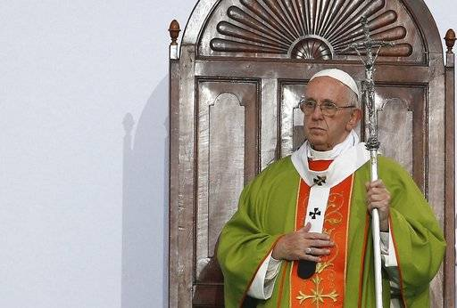 Pope Francis celebrates Mass at the Renato Dall'Ara stadium in Bologna, Italy, Sunday, Oct. 1, 2017. Pope Francis is on a one-day visit to the northern Italian towns of Cesena and Bologna.
