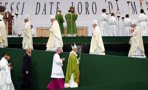 Pope Francis is flollowed by Monsignor Guido Marini, the papal master of liturgical ceremonies, as he arrives to celebrate Mass at the Renato Dall'Ara stadium in Bologna, Italy, Sunday, Oct. 1, 2017. Pope Francis is on a one-day visit to the northern Italian towns of Cesena and Bologna.