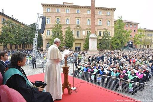 Pope Francis speaks during a meeting with university students in Bologna, Italy, Sunday, Oct. 1, 2017. Pope Francis is on a one-day visit to the northern Italian towns of Cesena and Bologna. (L'Osservatore Romano/ Pool Photo via AP)