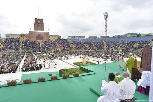 Pope Francis celebrates Mass at the Renato Dall'Ara stadium in Bologna, Italy, Sunday, Oct. 1, 2017. Pope Francis is on a one-day visit to the northern Italian towns of Cesena and Bologna. (L'Osservatore Romano/ Pool Photo via AP)
