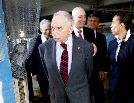 FILE - In this May 25, 2011 file photo, Conde Nast chairman, Si Newhouse Jr., leaves a news conference in New York. The billionaire media mogul died at his New York home, Sunday, Oct. 1, 2017. He was 89.