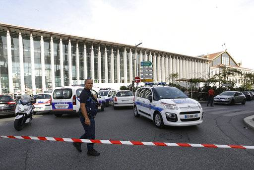 A French police officer cordons off the access to Marseille 's main train station Sunday, Oct. 1, 2017 in Marseille, southern France. French police have warned people to avoid Marseille's main train station following a knife attack that made at least one dead.