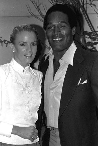 "FILE - In this May 6, 1980, file photo, former football star O.J. Simpson and friend, Nicole Brown get together at party Monday night, in Beverly Hills section of Los Angeles. The couple attended introduction party for a new geometric puzzle invented in Hungary and being distributed here as ""Rubik's Cube."" A Nevada prison official said early Sunday, Oct. 1, 2017, O.J. Simpson, the former football legend and Hollywood star, has been released from a Nevada prison in Lovelock after serving nine years for armed robbery."