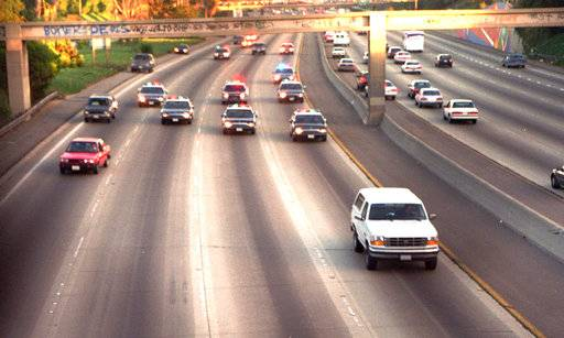 FILE - In this June 17, 1994, file photo, a white Ford Bronco, driven by Al Cowlings and carrying O.J. Simpson, is trailed by police cars as it travels on a southern California freeway in Los Angeles. Cowlings and Simpson led authorities on a chase after Simpson was charged with two counts of murder in the deaths of his ex-wife and her friend. On June 17, 1994: Ordered by prosecutors to surrender, Simpson instead flees with a friend in a white Ford Bronco. It's a nationally televised slow-speed chase across California freeways until police persuade him to surrender.