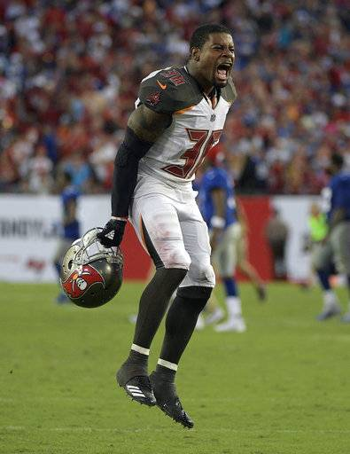 Tampa Bay Buccaneers defensive back Robert McClain (36) celebrates after the team defeated the New York Giants 25-23 during an NFL football game Sunday, Oct. 1, 2017, in Tampa, Fla.
