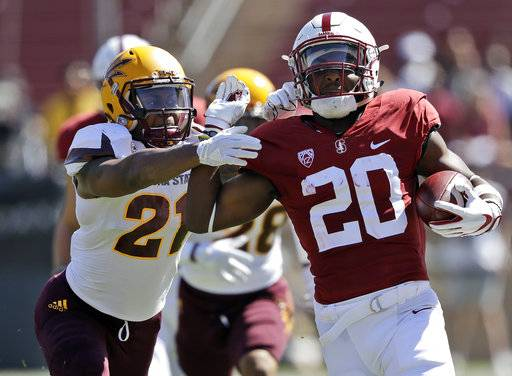 Stanford running back Bryce Love (20) runs for a touchdown past Arizona State defensive back Chad Adams (21) during the first half of an NCAA college football game Saturday, Sept. 30, 2017, in Stanford, Calif.