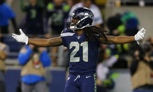 Seattle Seahawks' J.D. McKissic celebrates after he scored a touchdown against the Indianapolis Colts in the second half of an NFL football game, Sunday, Oct. 1, 2017, in Seattle.