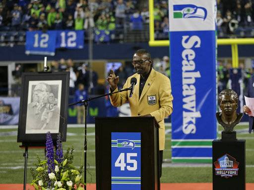 Seattle Seahawks hall-of-fame strong safety Kenny Easley speaks during a half-time ceremony to retire his No. 45 during an NFL football game between the Seahawks and the Indianapolis Colts, Sunday, Oct. 1, 2017, in Seattle.
