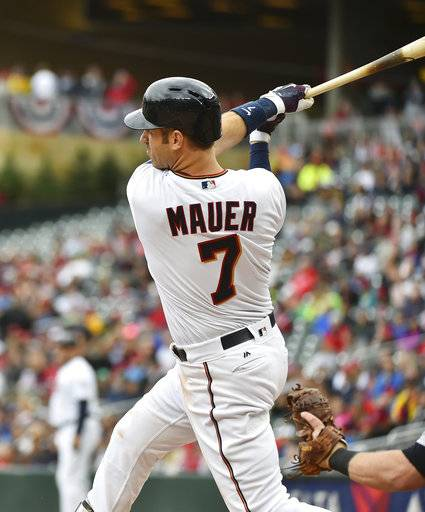 Minnesota Twins hitter Joe Mauer hits an RBI-double against the Detroit Tigers in the first inning of a baseball game, Sunday Oct. 1, 2017, in Minneapolis.