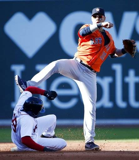 Boston Red Sox's Jackie Bradley Jr. (19) is forced out at second base as Houston Astros' Yuli Gurriel (10) turns the double play on Sam Travis during the fourth inning of a baseball game in Boston, Sunday, Oct. 1, 2017.