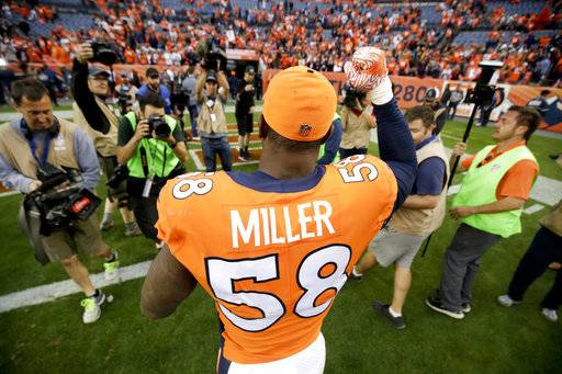 Denver Broncos outside linebacker Von Miller celebrates as he leaves the field after an NFL football game against the Oakland Raiders, Sunday, Oct. 1, 2017, in Denver.
