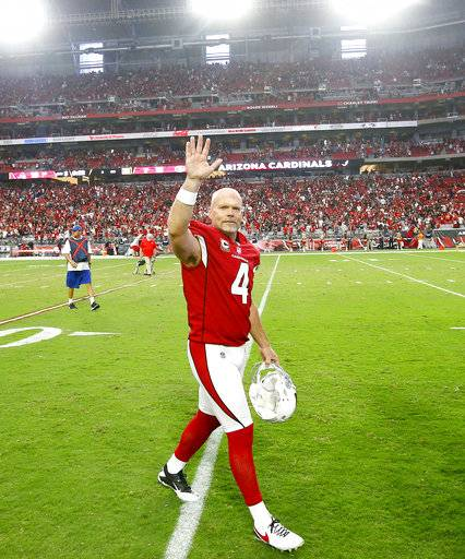 Arizona Cardinals kicker Phil Dawson (4) waves to fans as he leaves the field after overtime of an NFL football game against the San Francisco 49ers, Sunday, Oct. 1, 2017, in Glendale, Ariz. The Cardinals won 18-15.
