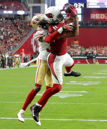 Arizona Cardinals wide receiver Larry Fitzgerald (11) pulls in the game winning touchdown as San Francisco 49ers cornerback Rashard Robinson defends during overtime of an NFL football game, Sunday, Oct. 1, 2017, in Glendale, Ariz. The Cardinals won 18-15.