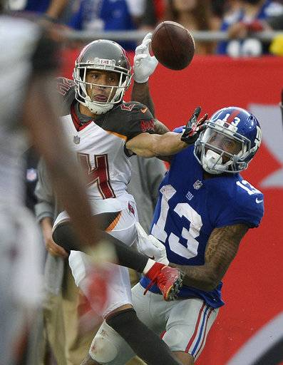 Tampa Bay Buccaneers cornerback Brent Grimes (24) breaks up a pass intedned for New York Giants wide receiver Odell Beckham Jr., during the fourth quarter of an NFL football game Sunday, Oct. 1, 2017, in Tampa, Fla.