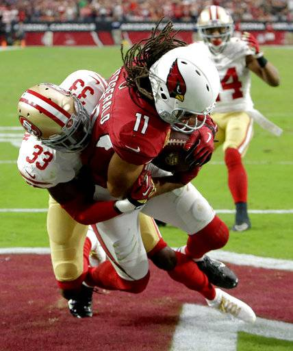 Arizona Cardinals wide receiver Larry Fitzgerald (11) pulls in the game winning touchdown as San Francisco 49ers cornerback Rashard Robinson (33) defends during overtime of an NFL football game, Sunday, Oct. 1, 2017, in Glendale, Ariz. The Cardinals won 18-15.