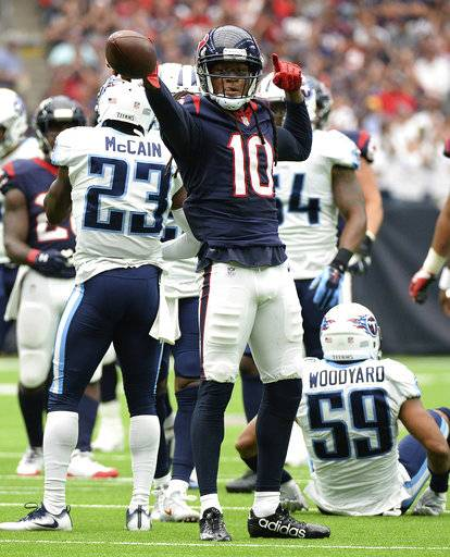 Houston Texans wide receiver DeAndre Hopkins (10) celebrates a catch for a first down against the Tennessee Titans during the first half of an NFL football game, Sunday, Oct. 1, 2017, in Houston.