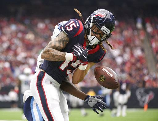 Houston Texans wide receiver Will Fuller (15) can't hold on to a pass as he is hit by Tennessee Titans cornerback Adoree' Jackson (25) during the second half of an NFL football game, Sunday, Oct. 1, 2017, in Houston.
