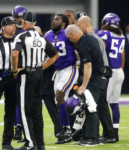 Minnesota Vikings running back Dalvin Cook (33) is helped off the field after being injured during the second half of an NFL football game against the Detroit Lions, Sunday, Oct. 1, 2017, in Minneapolis.