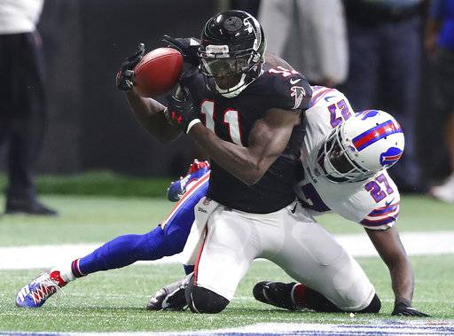 Falcons wide receiver Julio Jones makes a five yard reception against  Buffalo Bills cornerback Tre'Davious White during the first half of a NFL football game, Sunday, Oct. 1, 2017, in Atlanta. (Curtis Compton/Atlanta Journal-Constitution via AP)