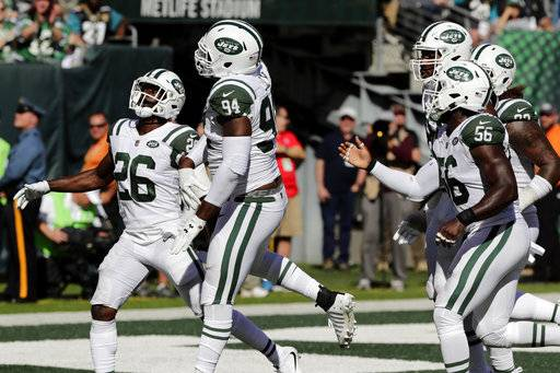 New York Jets' Kony Ealy, second from left, celebrates his interception with Marcus Maye, left, and others during the second half of an NFL football game against the Jacksonville Jaguars, Sunday, Oct. 1, 2017, in East Rutherford, N.J.