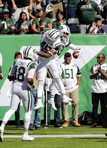 New York Jets' Rontez Miles, left, and Marcus Williams celebrate after running a fake punt play during the first half of an NFL football game against the Jacksonville Jaguars, Sunday, Oct. 1, 2017, in East Rutherford, N.J.