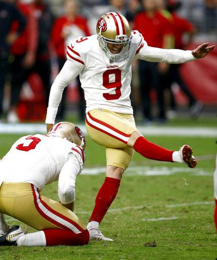 San Francisco 49ers kicker Robbie Gould (9) kicks a field goal during overtime of an NFL football game as punter Bradley Pinion (5) holds against the Arizona Cardinals, Sunday, Oct. 1, 2017, in Glendale, Ariz.