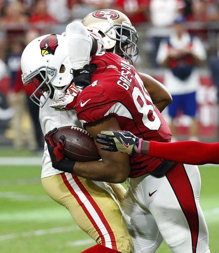 Arizona Cardinals tight end Jermaine Gresham, right, is hit by San Francisco 49ers free safety Jaquiski Tartt during the second half of an NFL football game, Sunday, Oct. 1, 2017, in Glendale, Ariz.